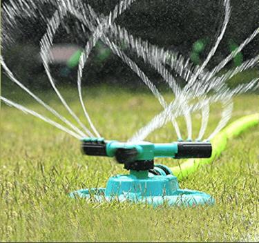 Sprinkler system in lawn.
