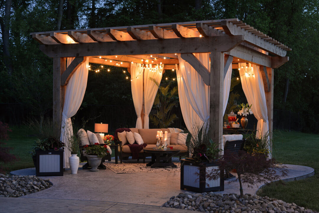Outdoor patio with pergola and lighting